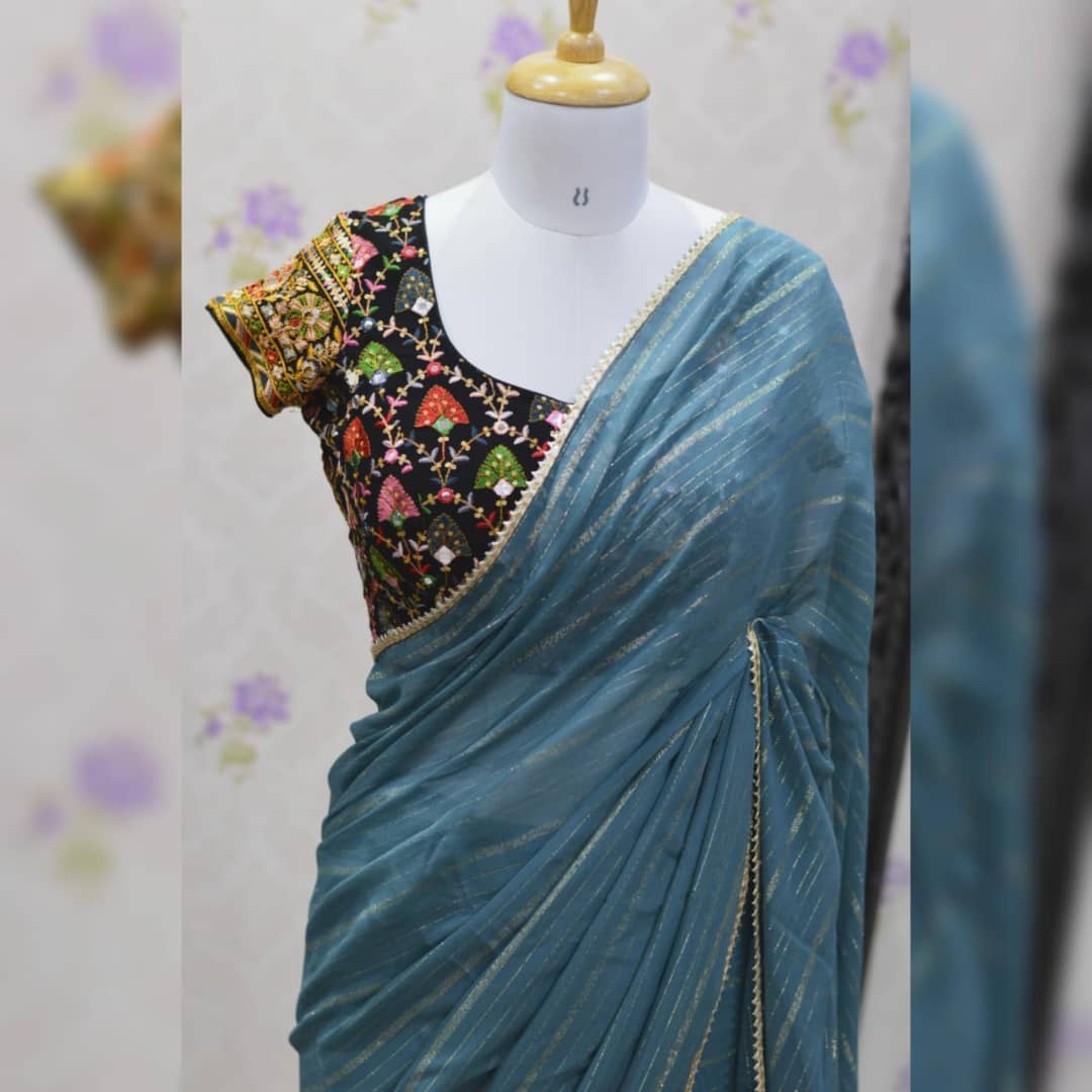 Awesome ..Gary color pure georgette saree paired up with famous  Black Gujri embroidery work blouse and Belt.  Blouse sizes can be customized. Collection no:024SHV.. For price details inbox  or watsapp on +917799503713.. 2021-10-17