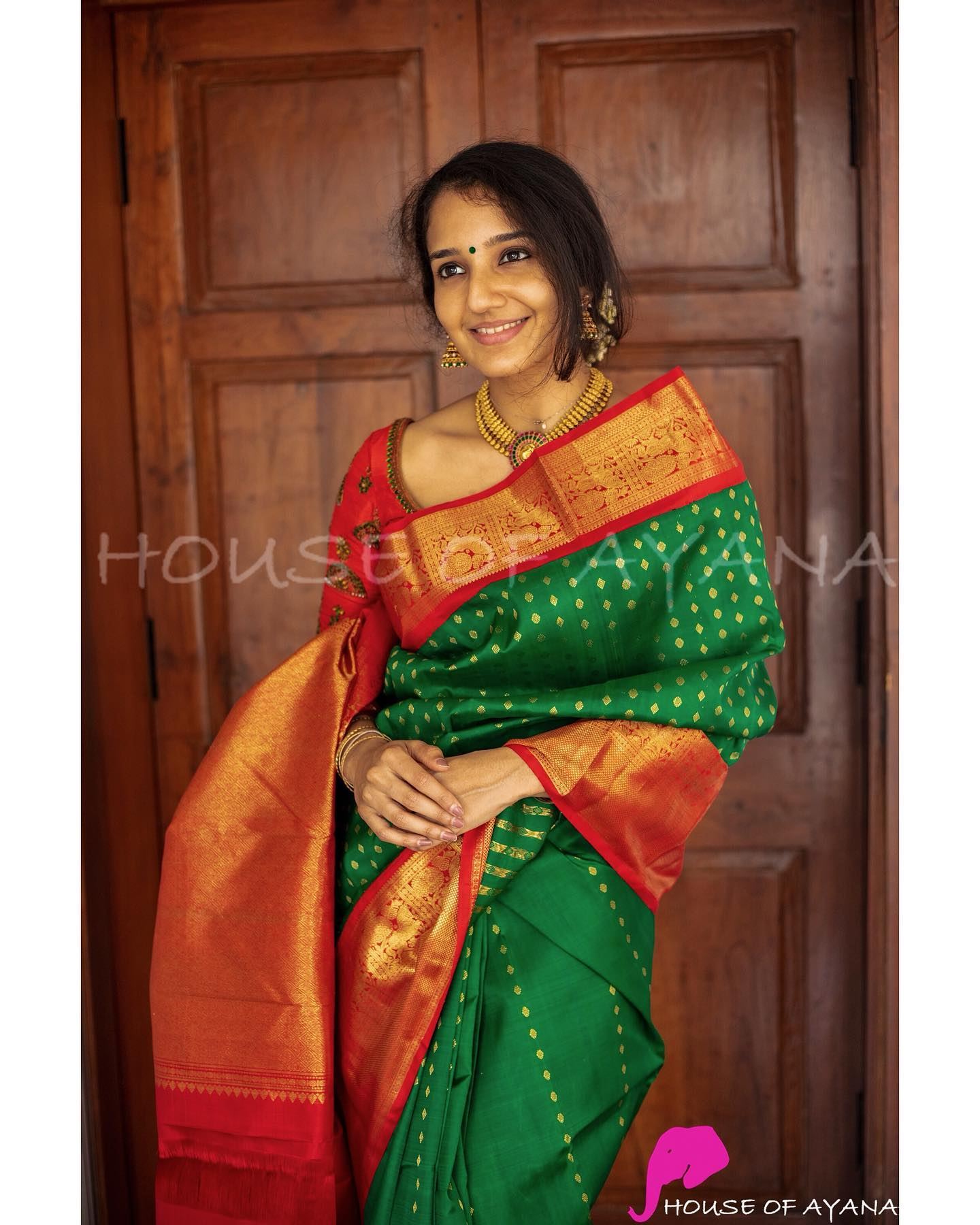 Kanjivaram pure silk saree in leaf green handwoven with zari motifs all over the saree and completed with elegant chilli red borders and a grand pallu of the same color. Blouse: Chilli red silk blouse in the color of the pallu with coordinated borders. Price : Rs. 42499.00/-- 2021-10-18