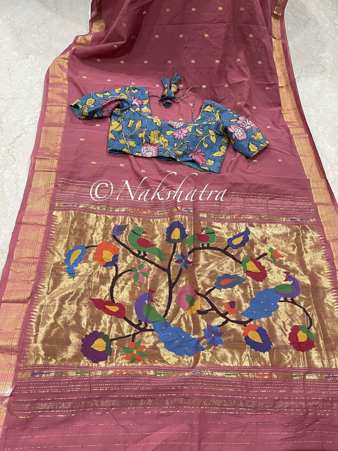 Handwoven cotton pythani saree with beautiful zari woven pallu and excellent combos paired with stunning silk pen  kalamkari blouses  Blouse size -36/38 and extends upto 42 Blouses Can be customized to bigger sizes also . 2021-10-18
