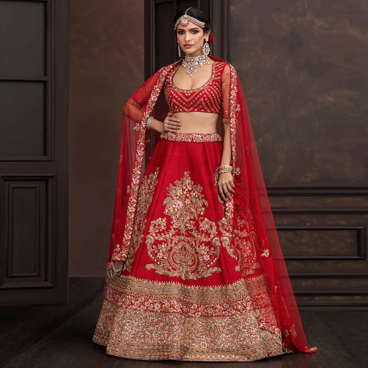 A deep-red raw silk lehenga with ornate zardosi and peeta embroidery done in vintage gold. . Wedding Couture 21-22. Shyamal and Bhumika. 2021-10-18