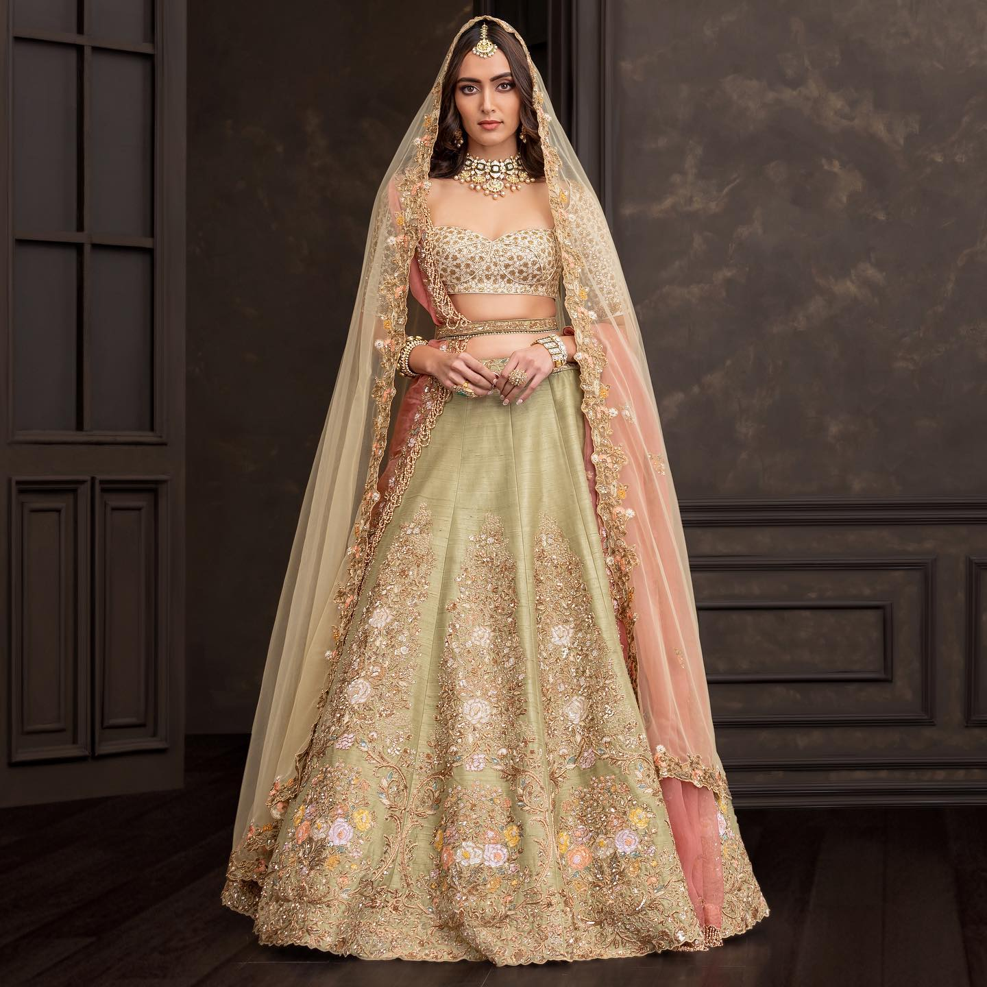 Stunning olive green color raw silk bridal lehenga set with classy hand embroidery  work. 2021-10-18