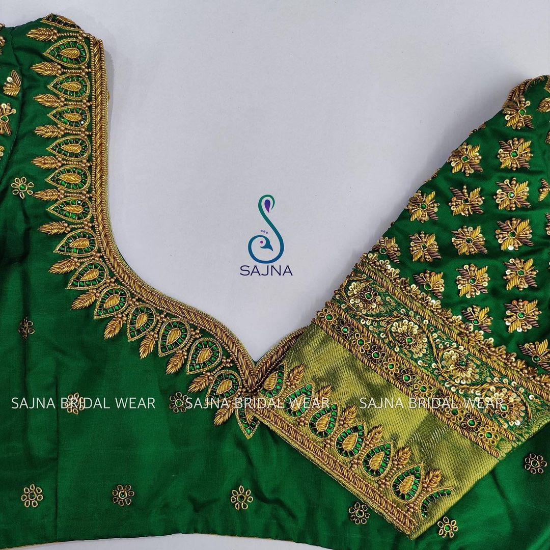 Gorgeous green color bridal blouse with mango and floral zardosi work. 2021-10-18