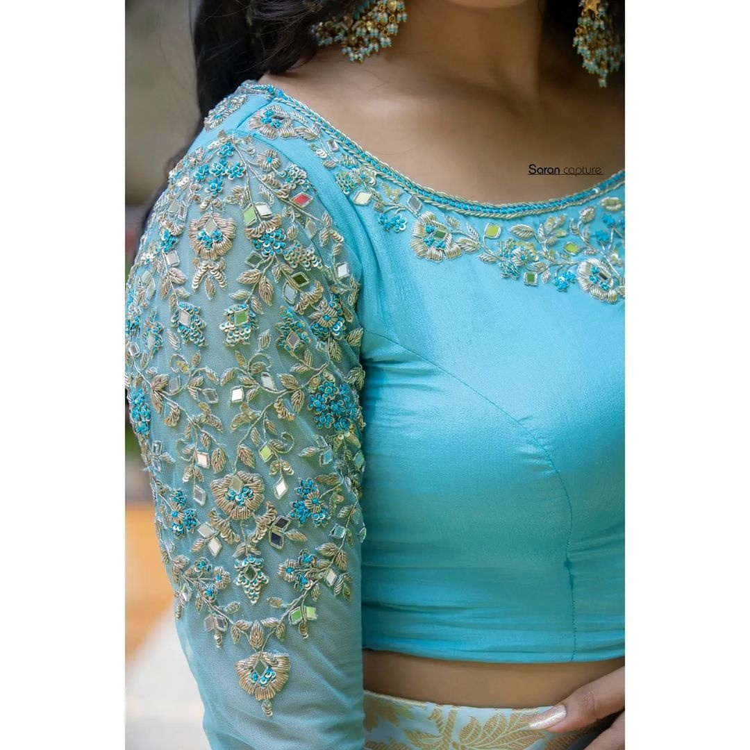 Gorgeous Icy blue color bridal blouse with floret lata hand embroidery silver thread and mirror aari work.  2021-10-19