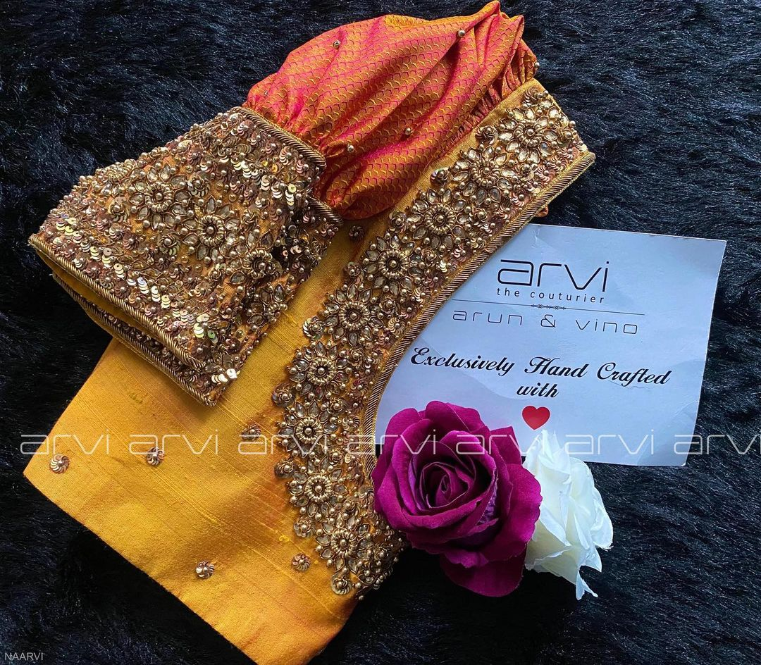 Gorgeous mustard yellow bridal blouse with floral heavy zardosi work on neckline and sleeves. 2021-10-19