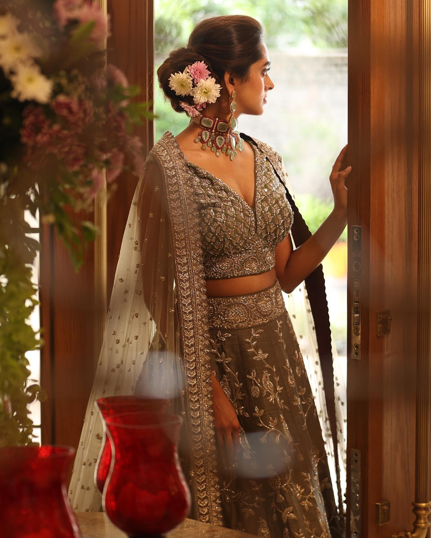The subtle elegance of olive green romanced with delicate hand-embroidery in Mynah Lehenga. Jewellery : Vasundhara Diamond roof. 2021-10-20