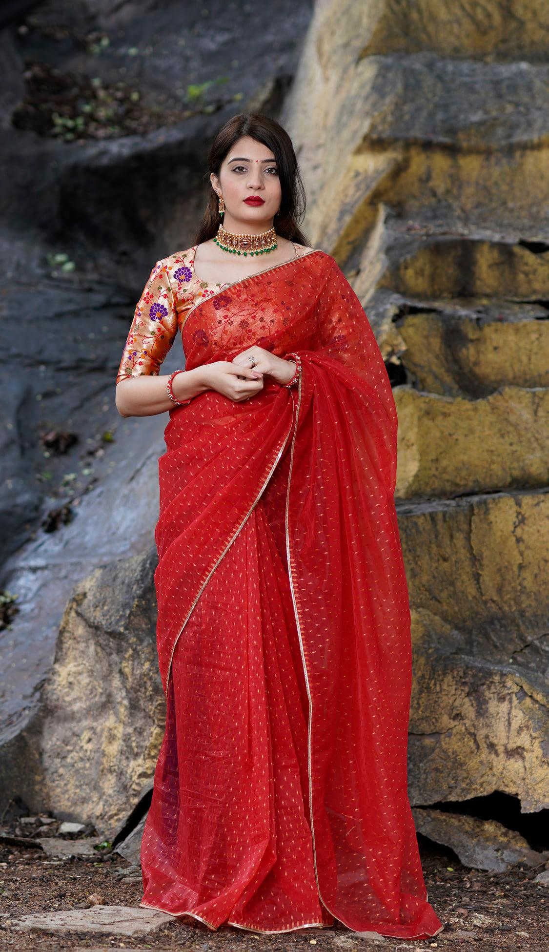 Red organza. Price - Rs 5000. Red zari buttis organza saree finished with a golden zari border. Unstitched blouse piece - Red golden paithani blouse piece. Please whatsapp for orders - 7995481918. Email - privacollective@gmail.com. 2021-10-20