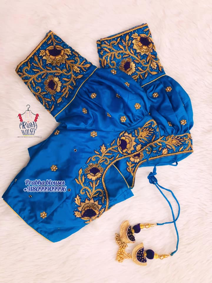 Gorgeous blue color puff sleeve blouse with floral and creeper hand embroidery gold thread and bead maggam work.  2021-10-20
