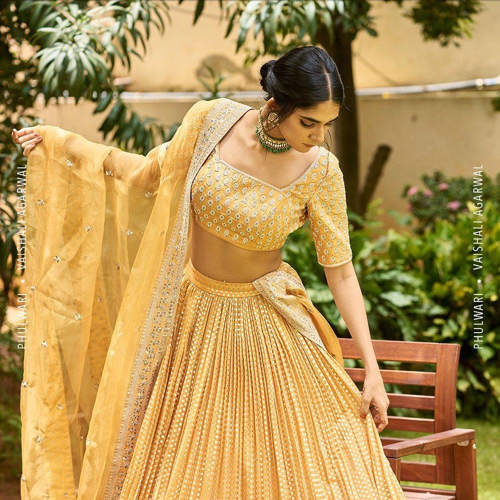 Phulwari . Kritya in Daffodil yellow lehenga set. The intricately embroidered blouse with zardozi and bead work comes with a Chanderi banarasi lehenga and an embellished dupatta with all over buttis.  To shop new collection Phulwari Whatsapp us on +91 99083 48333. 2021-10-20