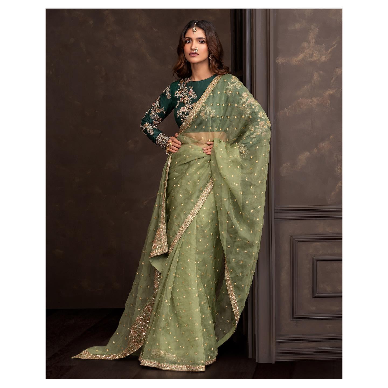 An olive-green organza saree with zari aari embroidery. . Wedding Couture 21-22 Shyamal and Bhumika. 2021-10-20
