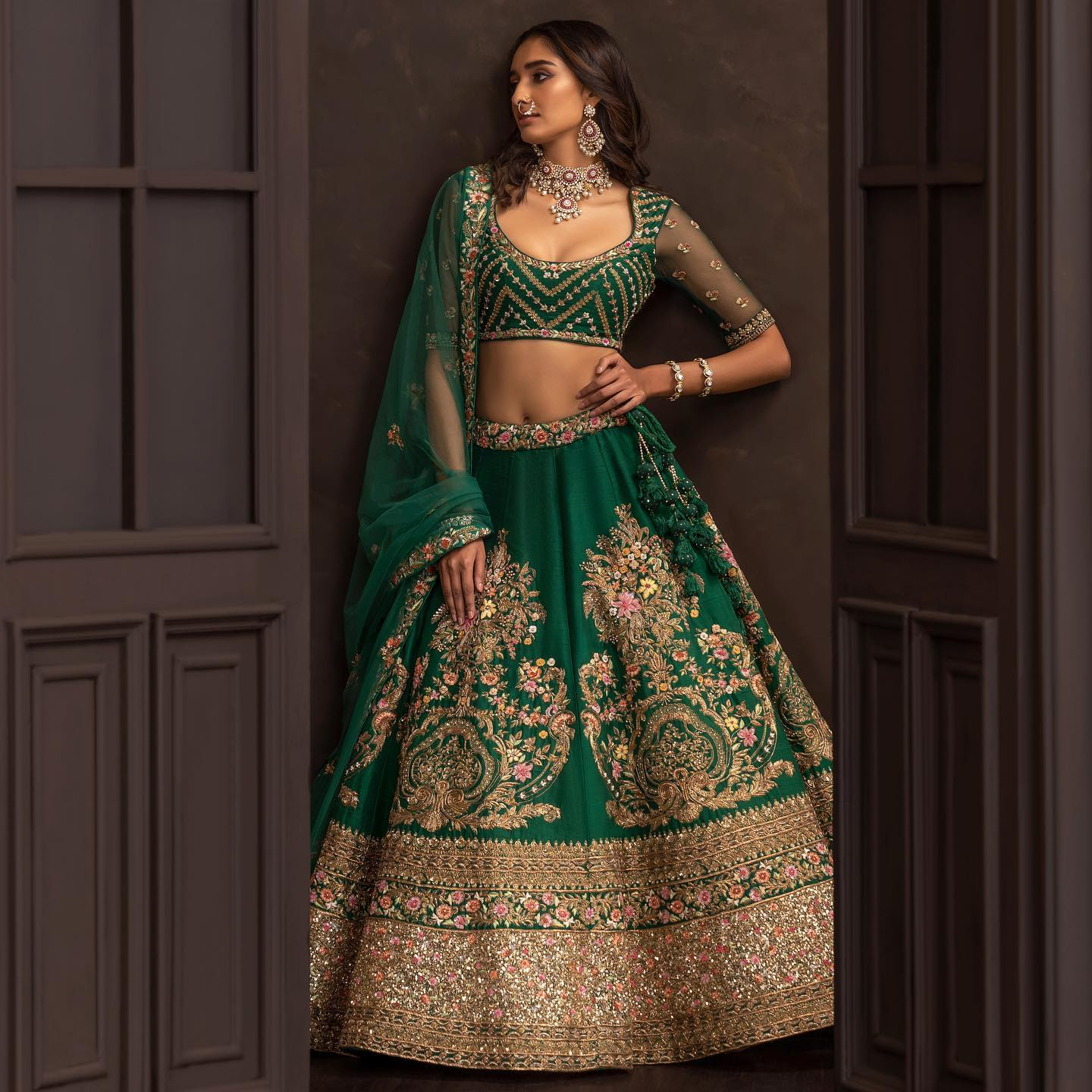 A forest-green raw silk lehenga with ornate vintage-gold hand embroidery. . Wedding Couture 21-22 Shyamal and Bhumika. 2021-10-20