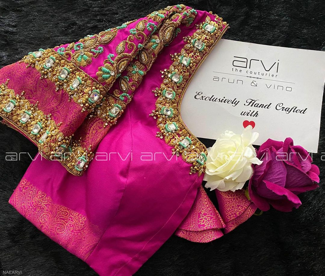 Gorgeous pink color bridal blouse with bead and kundan aari work on neckline and sleeves. 2021-10-20
