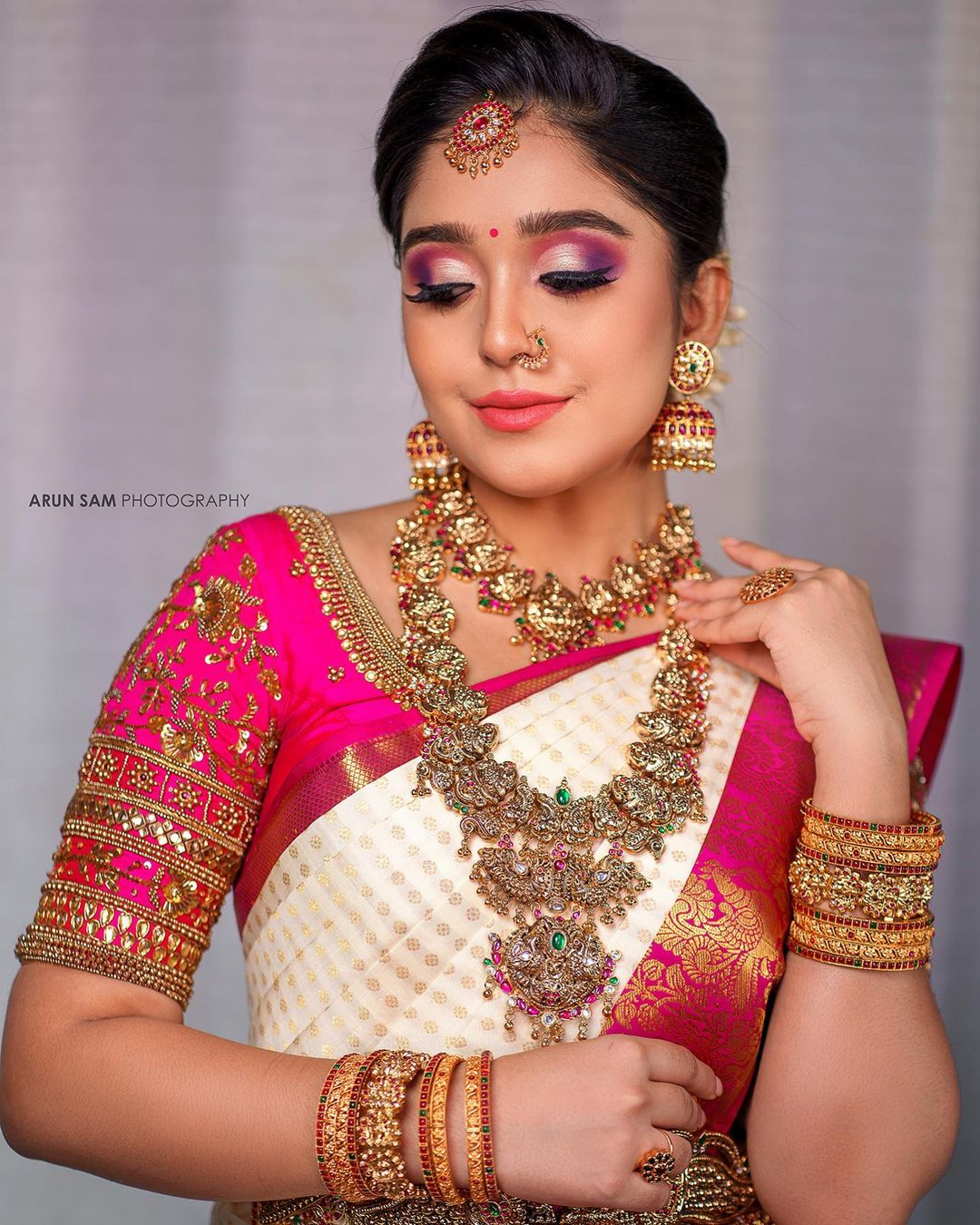 Gorgeous pink color bridal blouse with bead and kundan zardoi work on neckline and sleeves. Saree : Aaryanair designs. 2021-10-20