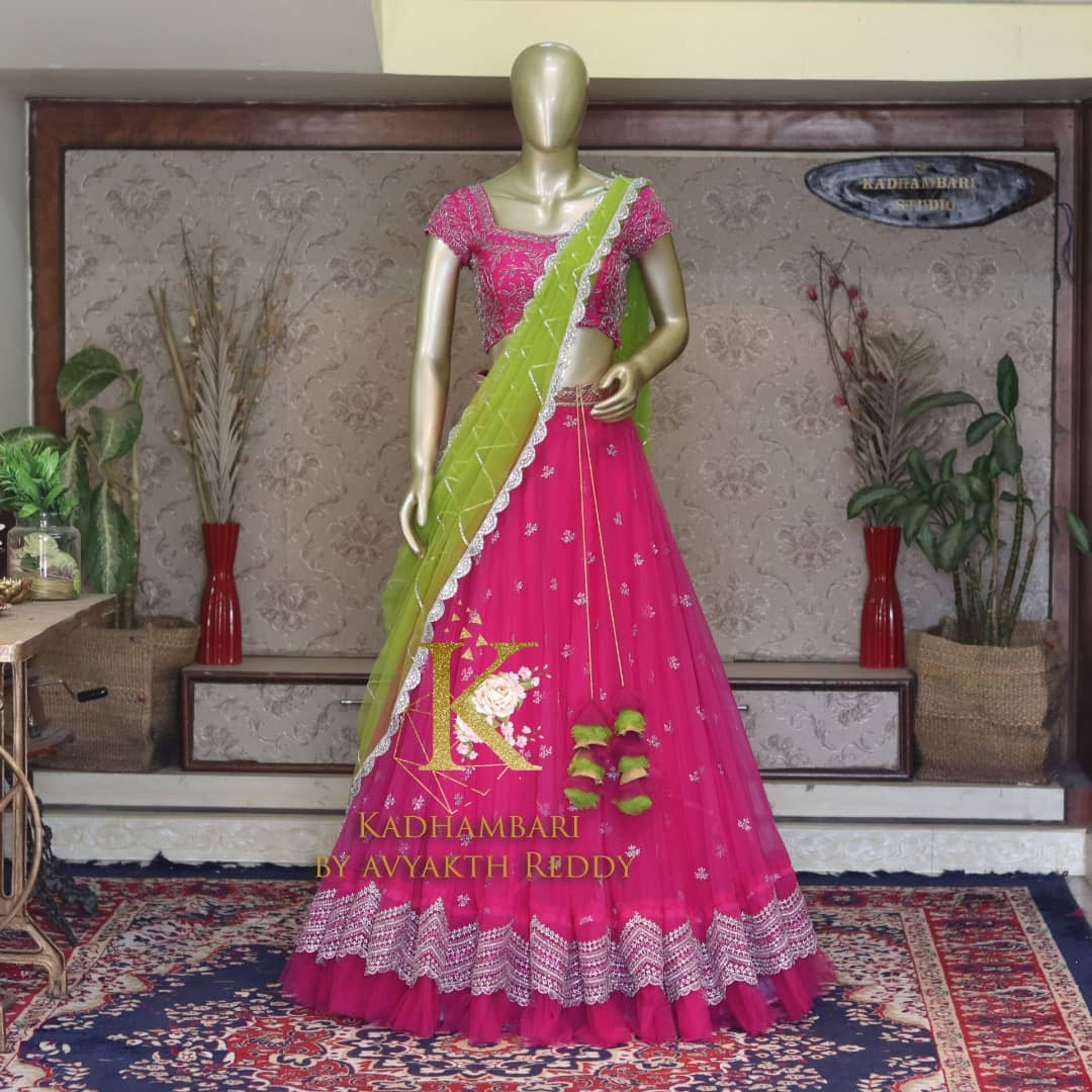 Gorgeous blush pink color net lehenga and blouse with parrot green color net dupatta. Blouse and lehenga with hand embroidery work.  2021-10-20