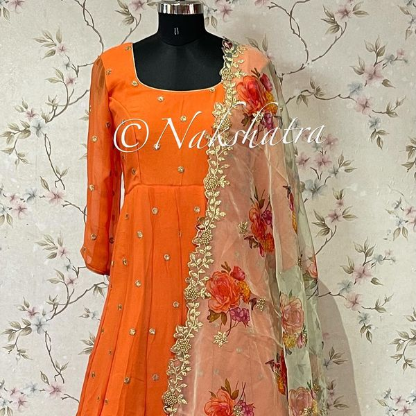 Light orange gorgette buti long frock paured with different organza floral dupattas with cutwork borders. 2021-10-21