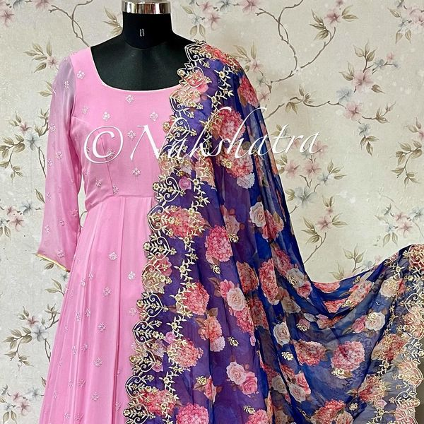 Stunning baby pink pure gorgette long frock paired with organza floral and kalamkari dupattas with cutwork borders. 2021-10-21