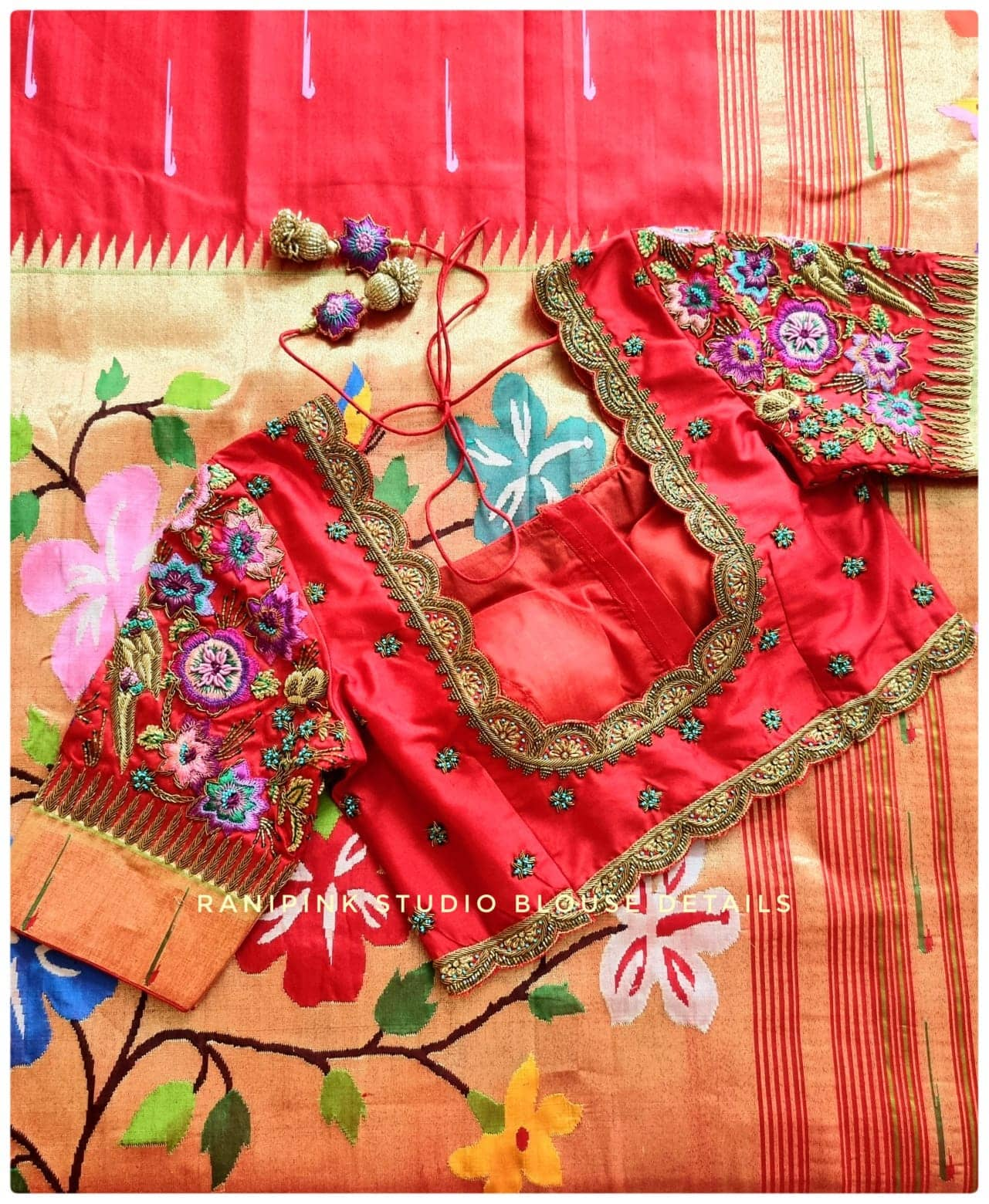New embroidery blouse paired with a beautiful Red paithani saree. Stunning red color bridal blouse with floral and parrots hand embroidery thread maggam work.  . . For appointments call or whatapp at 8884620620. 2021-10-21