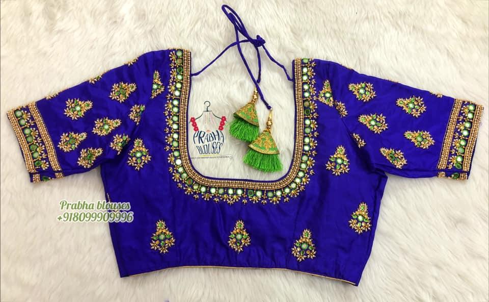 Stunning royal blue color bridal blouse with kundan and mirror aari work.  2021-10-21