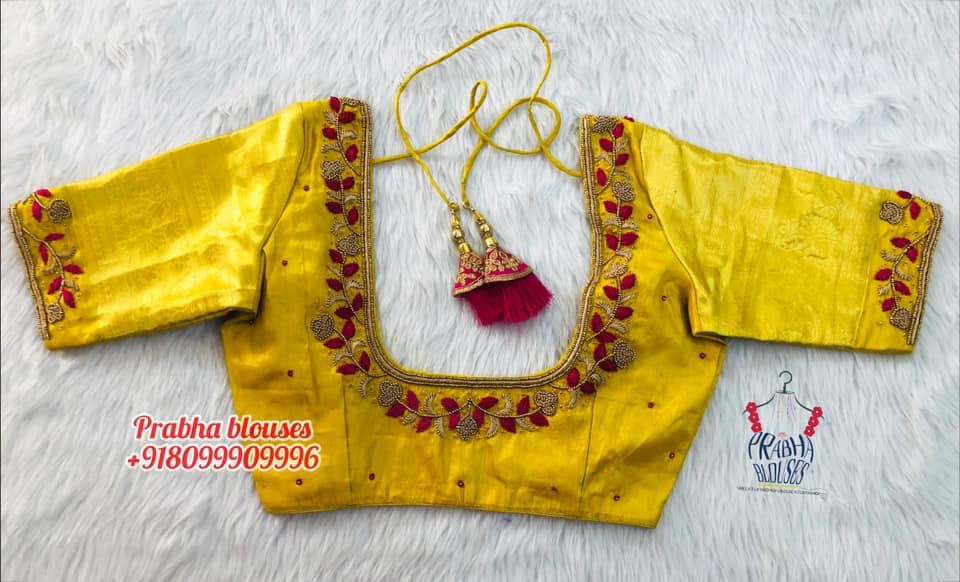 Gorgeous yellow color bridal blouse with floral and creeper hand embroidery bead and thread maggam work on neckline.  2021-10-21