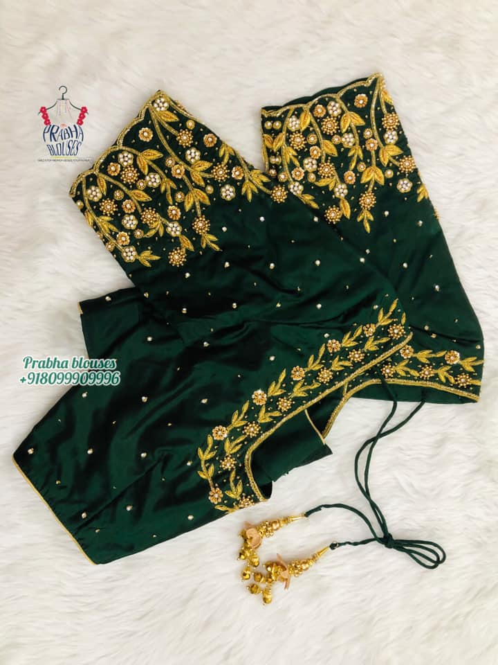 Stunning bottle green color bridal blouse with floral and creeper kundan and gold thread maggam work. 2021-10-21