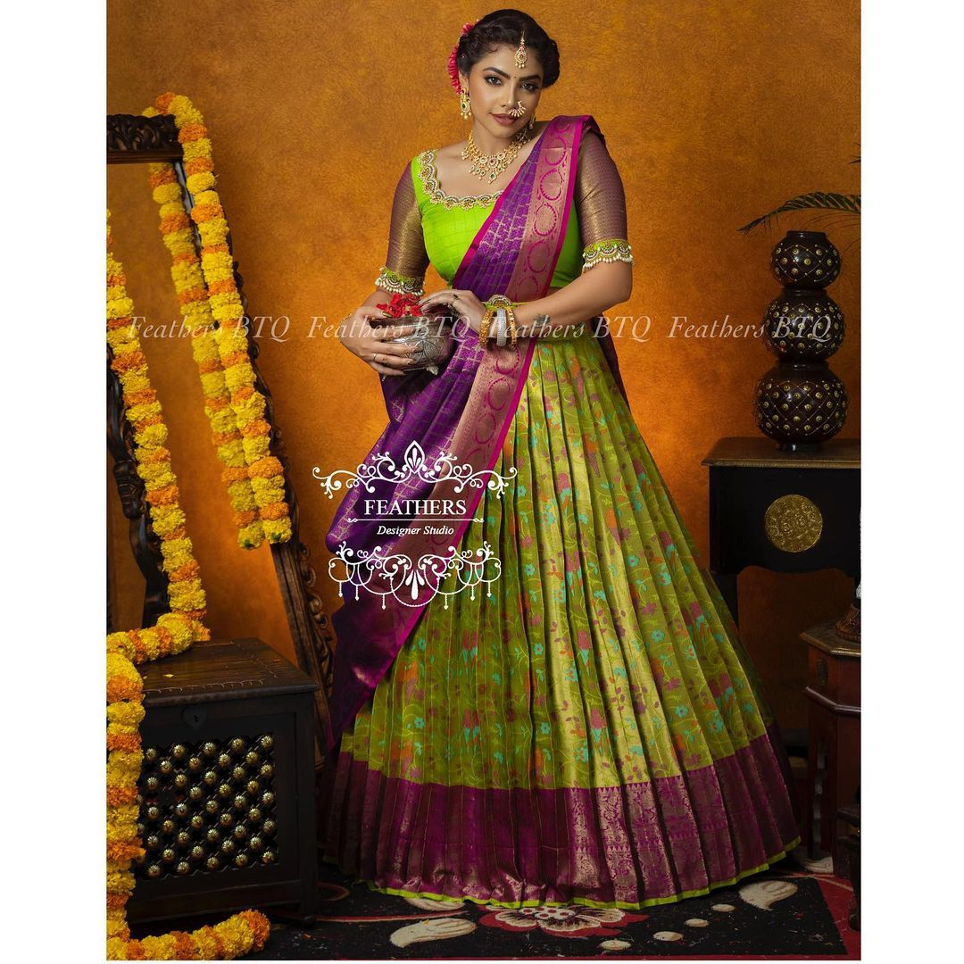 Stunning parrot green and purple color combination traditional pattu halfsaree. 2021-10-21