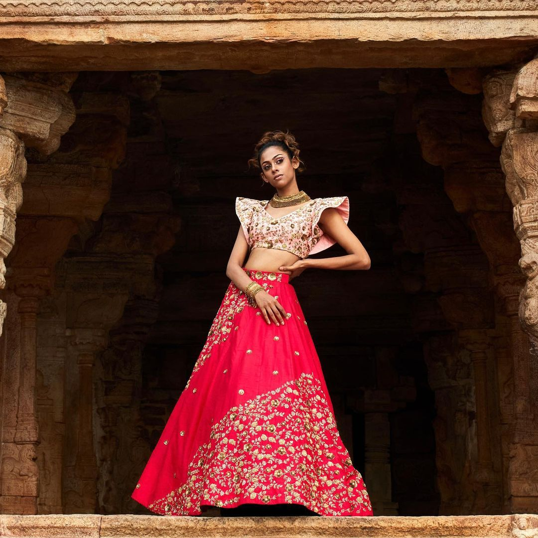 Some drama some structure and some geometry in shades of pinks and reds.  An intricately embroidered lehenga ensemble that is so modern in a very traditional setting. Sakura is all about a good mix of all the contemporary elements we desire and the conventional elements we heart! 2021-10-21