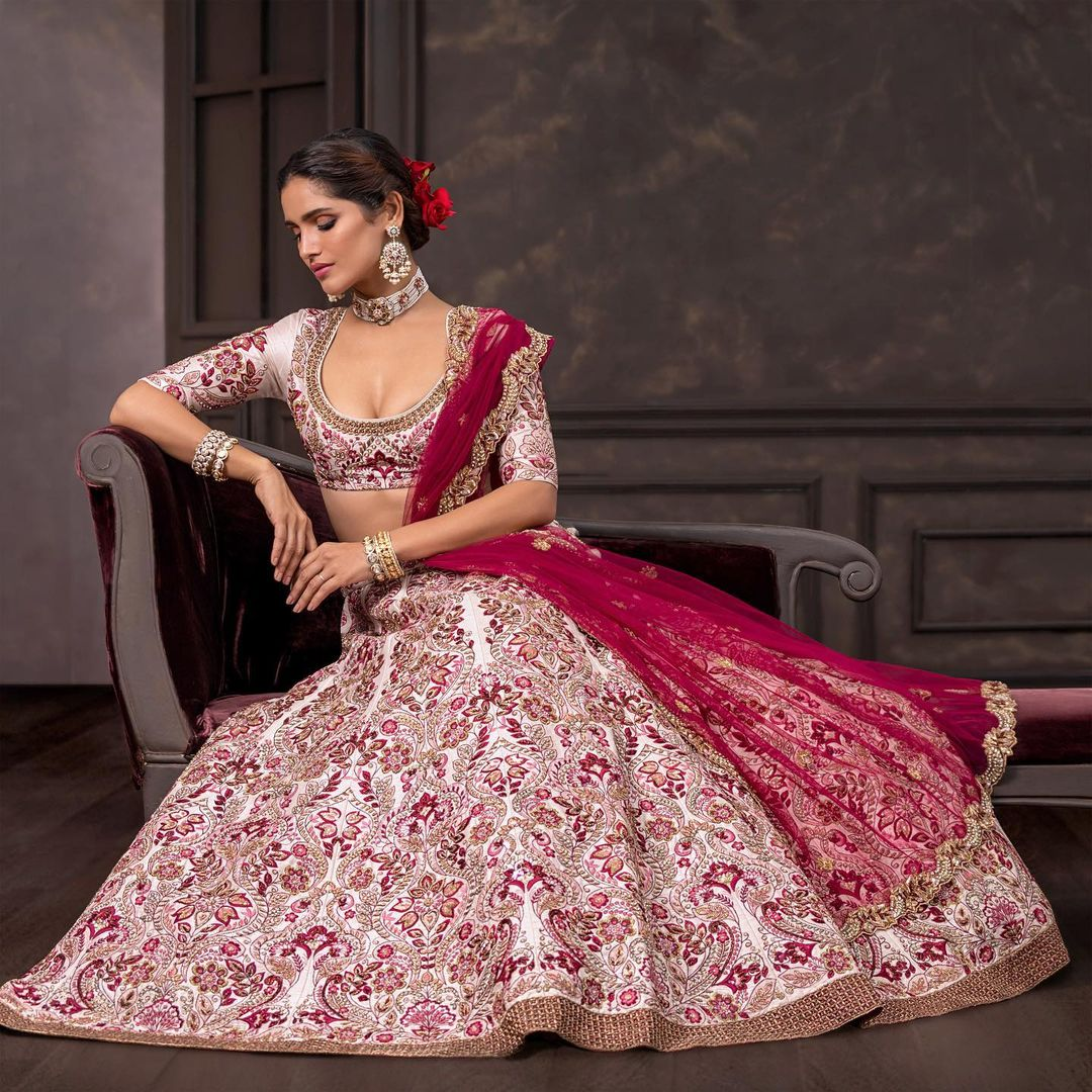 A classic kalidaar panelled raw silk lehenga in shell-pink  with contrast thread embroidery. . Wedding Couture 21-22 Shyamal and Bhumika. 2021-10-21
