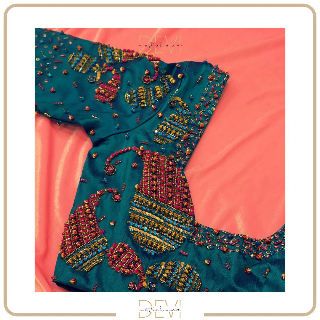 Paisley inspired bold bluish cyan raw-silk blouse with parallel-array embellishments combined with splash and throw tone. For bespoke appointments and enquiries: Call or WhatsApp on +91-99441-33022. 2021-10-22