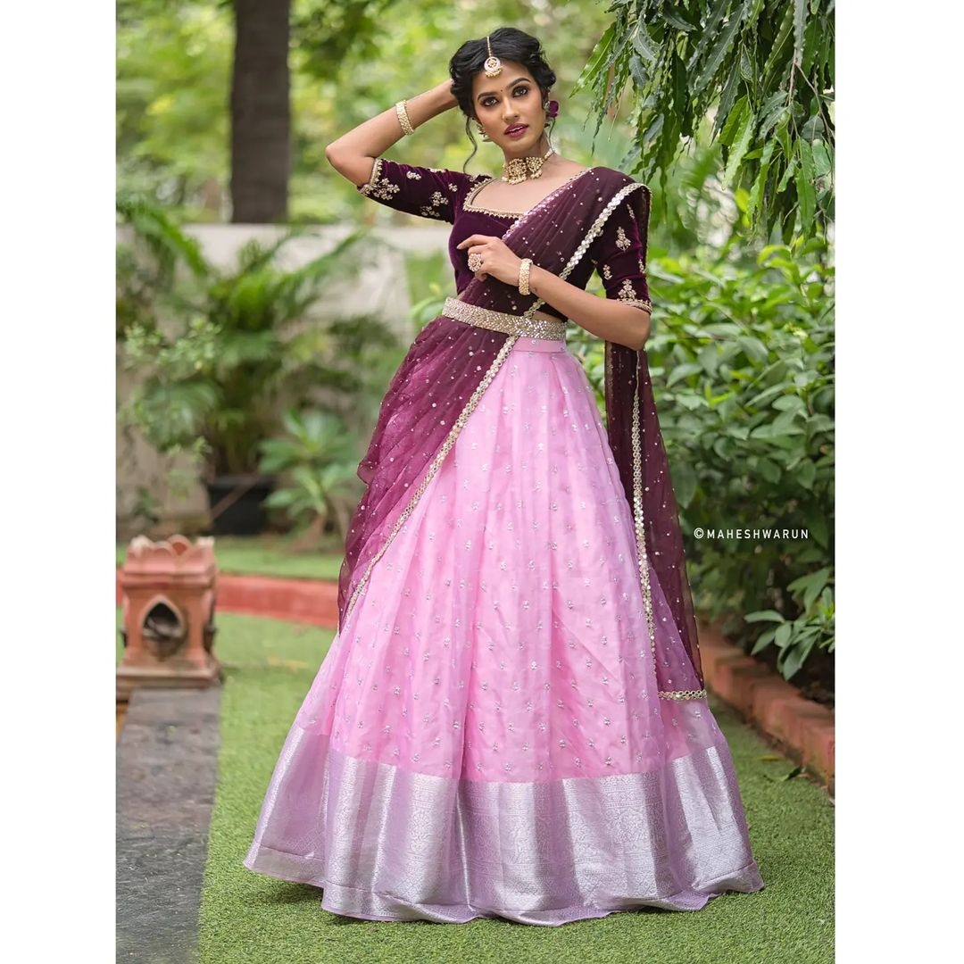 Wine on pink half saree. .  Pink organza pleated skirt paired with  embroidered wine  velvet blouse and duaptta finished with mirror border. Place your orders now!  For orders and queries please whatsapp on  9952093562 or Reach  on 044 4262 4085 . 2021-10-22